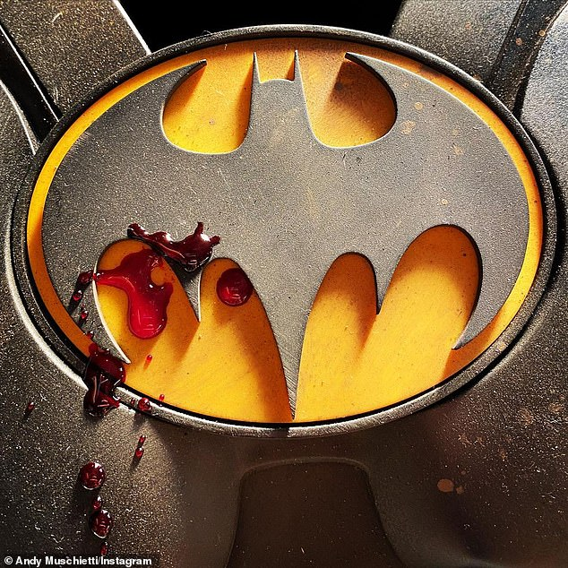 An inside look: The Flash's director, Andy Muschietti, shared an image of a blood-spattered Batman logo to his Instagram account on Friday