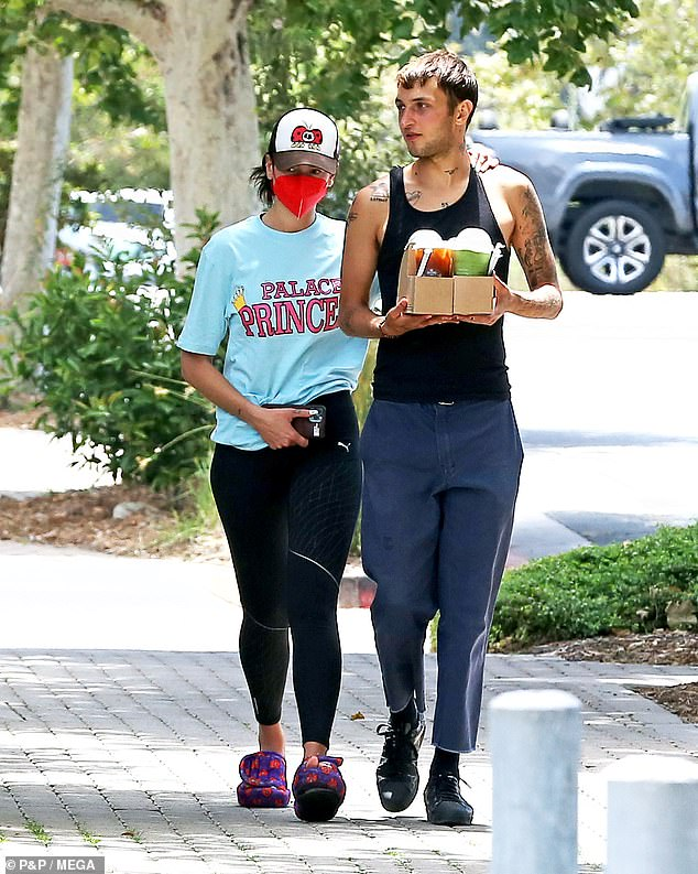 Loved-up:Dua Lipa, 25, and Anwar Hadid, 21, proved they're still going strong on Friday when they stepped out for a juice run in Malibu, with Dua resting her arm on her boyfriend's shoulder