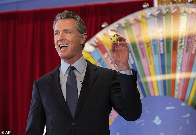 California Governor Gavin Newsom (pictured) also announced state lottery winners on Friday, taking a gameshow host approach to the vaccination lottery