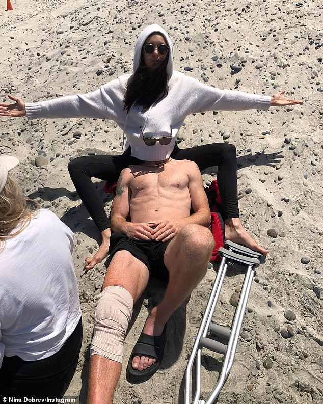 Recuperating: Shaun's knee was wrapped in gauze and a metal crutch was laying nearby. The skateboarding champion was injured recently during practice and had to withdraw from the 2021 X Games