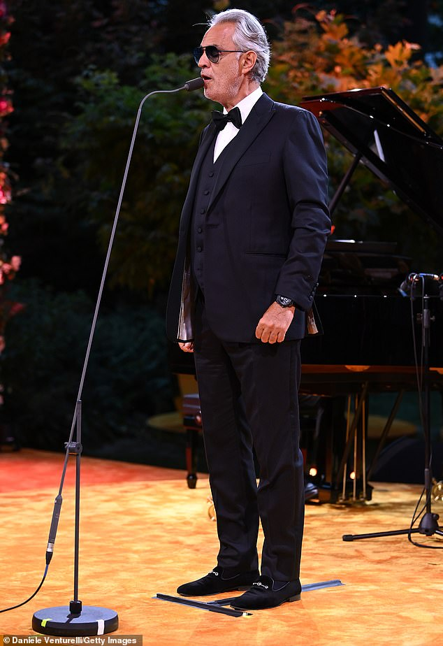 Looking smart: Andrea took to the stage wearing a smart tuxedo with a black bow tie and a crisp white shirt