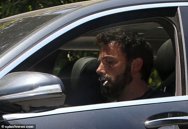On Friday: Ben Affleck was seen puffing away on a cigarette in the driver's seat of his car, as he left rekindled flame Jennifer Lopez's residence in Los Angeles