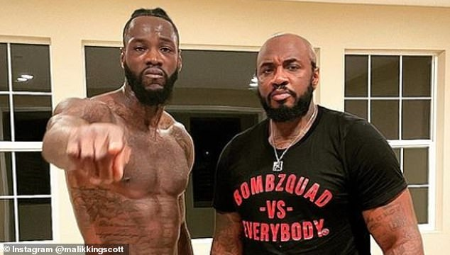 Wilder's new head trainer Malik Scott (right) branded the boxer's depression claims as 'bull****'