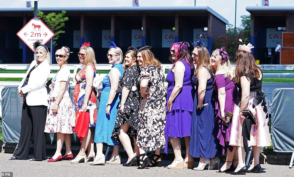 Towering heels and purple shades! This group sported purples, reds and black with high heels for the Derby day out in Surrey