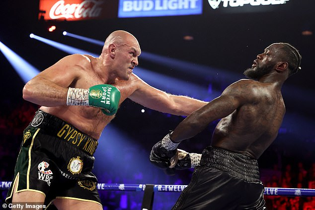 Fury (left) was told to have a trilogy fight with Deontay Wilder (right) which postponed the bout