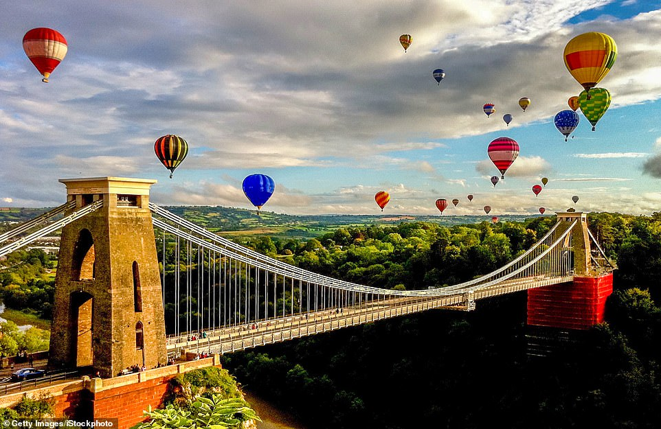 Rise to the occasion: Balloons fly over Bristol's Clifton suspension bridge during theBristol International Balloon Fiesta, which has been held in the city almost annually since 1979
