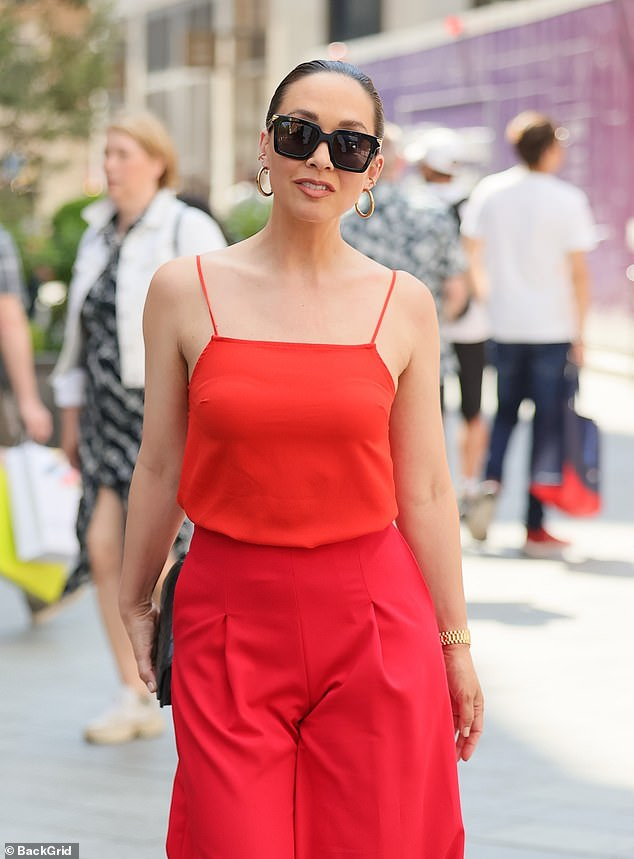 Sizzling:The Smooth Radio presenter, 43, caught the eye in a red camisole and matching flared trousers as she made her way to work on yet another scorching day in the capital