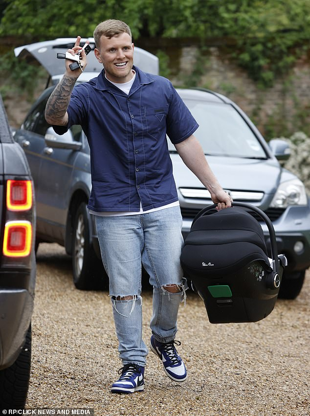 Doting parents:Tommy Mallet and Georgia Kousoulou, both 29, were in high spirits on Friday when they arrived at Hutton Hall in Brentwood with their one month old son Brody in tow
