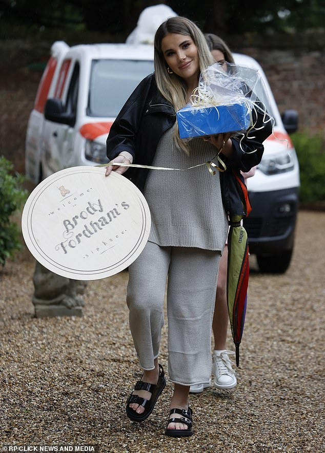 Attention to detail: Georgiealso carried signs adorned with Brody's name into the venue and opted for open-toe sandals for the celebrations