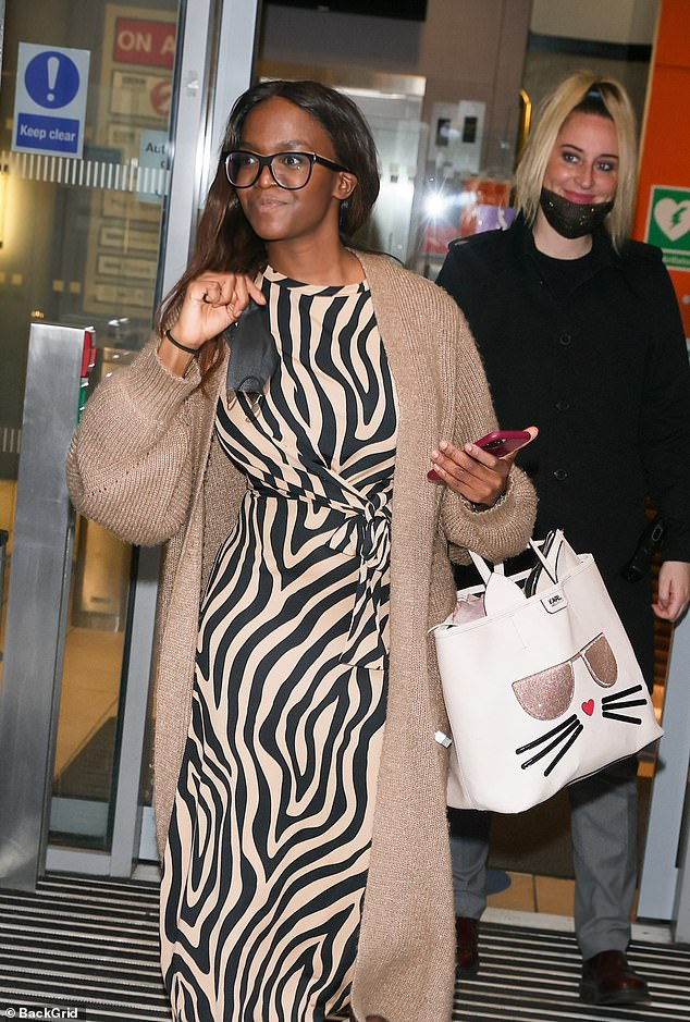 Enjoying the weekend: Oti appeared in high spirits and flashed photographers a smile as she went about her weekend