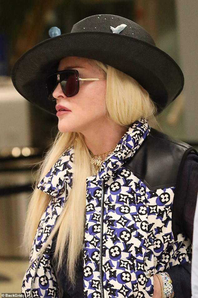 Unique:She added a quirky black cowboy hat decorated with scaly blue fish on the side and studded with tiny beads