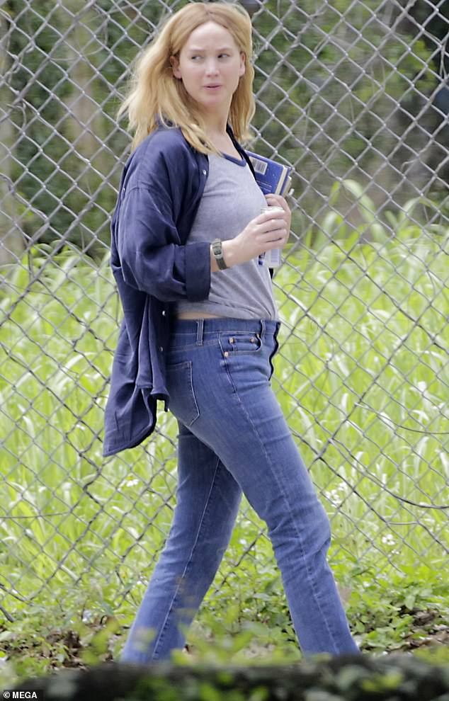 Ready:Jennifer was seen with can of Red Bull to try and stave off her tiredness and also made sure to bring a book for her spare time