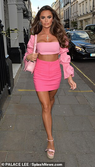 Accessories: Mia carried a quilted pink leather bag with her and opted for a bronzed makeup look for the night out