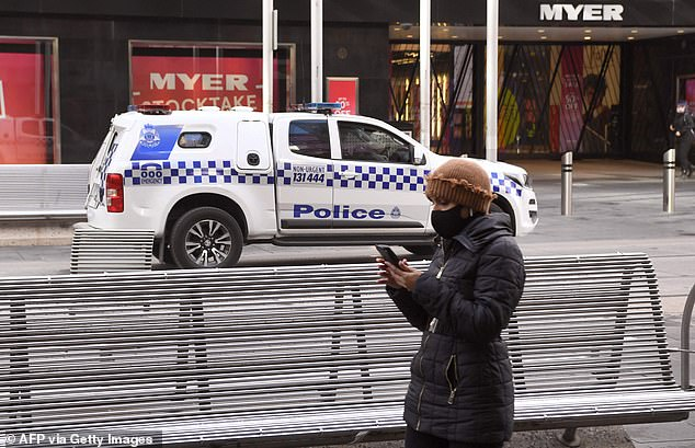 A police vehicle drives through Melbourne's normally bustling Bourke Street Mall as the city entered its second week of the fourth Covid lockdown
