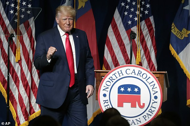 President Donald Trump, have seized on the emails as proof of a conspiracy to obscure the source of the virus. He is pictured on Saturday night in Greenville, North Carolina
