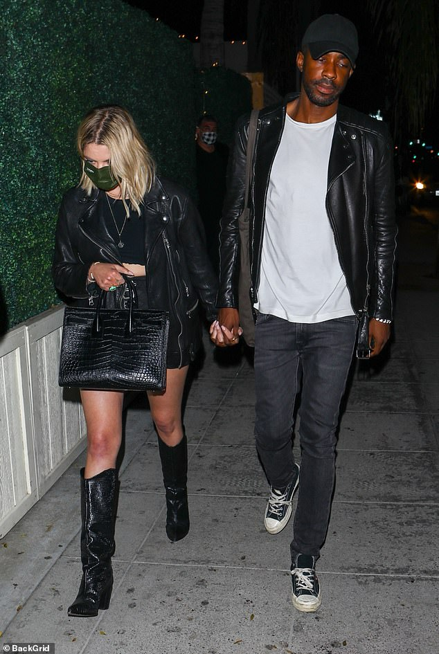 In fashion sync: The actress' mystery man wore a similar black outfit, which included a classic leather jacket, jeans and sneakers