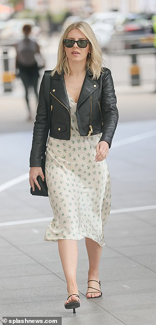 Details:She accessorised with simple hoop earrings and a black satchel bag