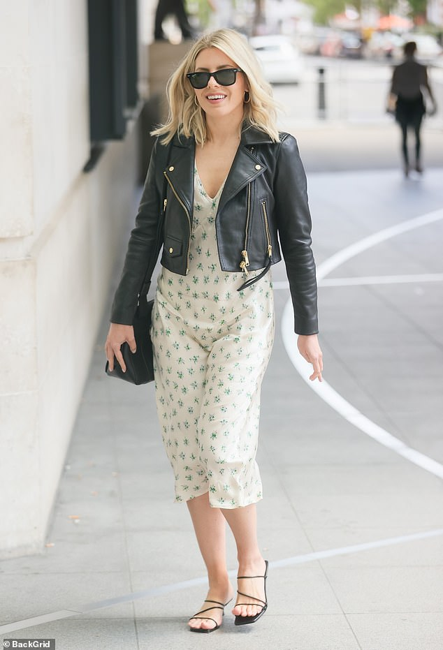 Arrival: Mollie King was seen looking incredibly chic in a pretty floral dress as she arrived for her show in London on Sunday morning