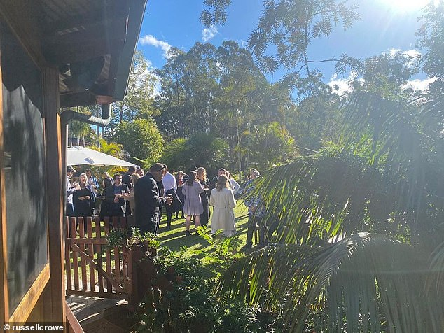 Guests: Russell shared a sunny image of mourners gathered at the wake