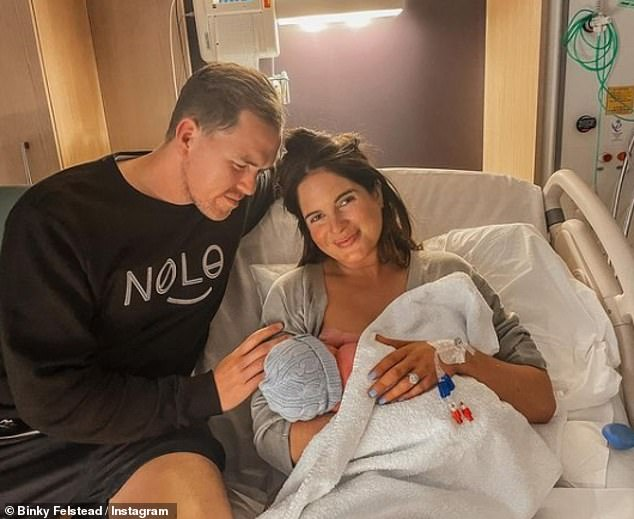 Doting parents:Their surprise ceremony took place seven weeks after Binky and Max, both 30, welcomed their son Wolfie into the world