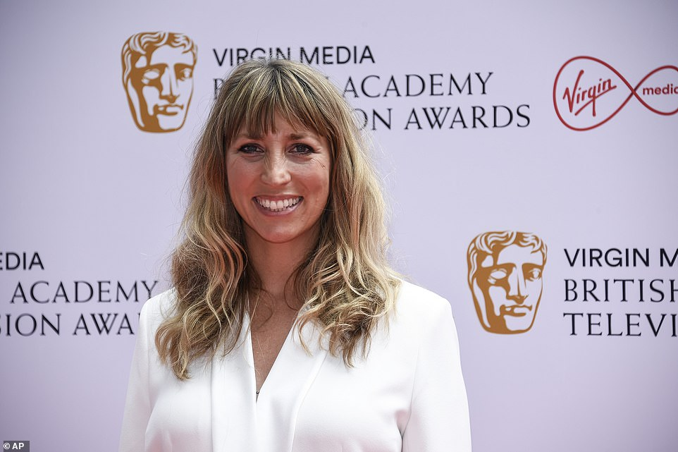Making waves: The screen star wore her golden locks in soft waves with a long fringe, while she kept her makeup natural