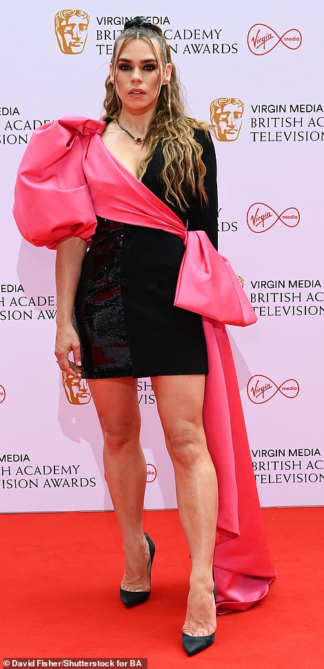 Pink: The star's ensemble was given a dramatic touch with a single puffy pink sleeve, which descended into a bow and train