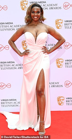 Gorgeous: Oti was a vision in her white strapless gown with a plunging bustier front