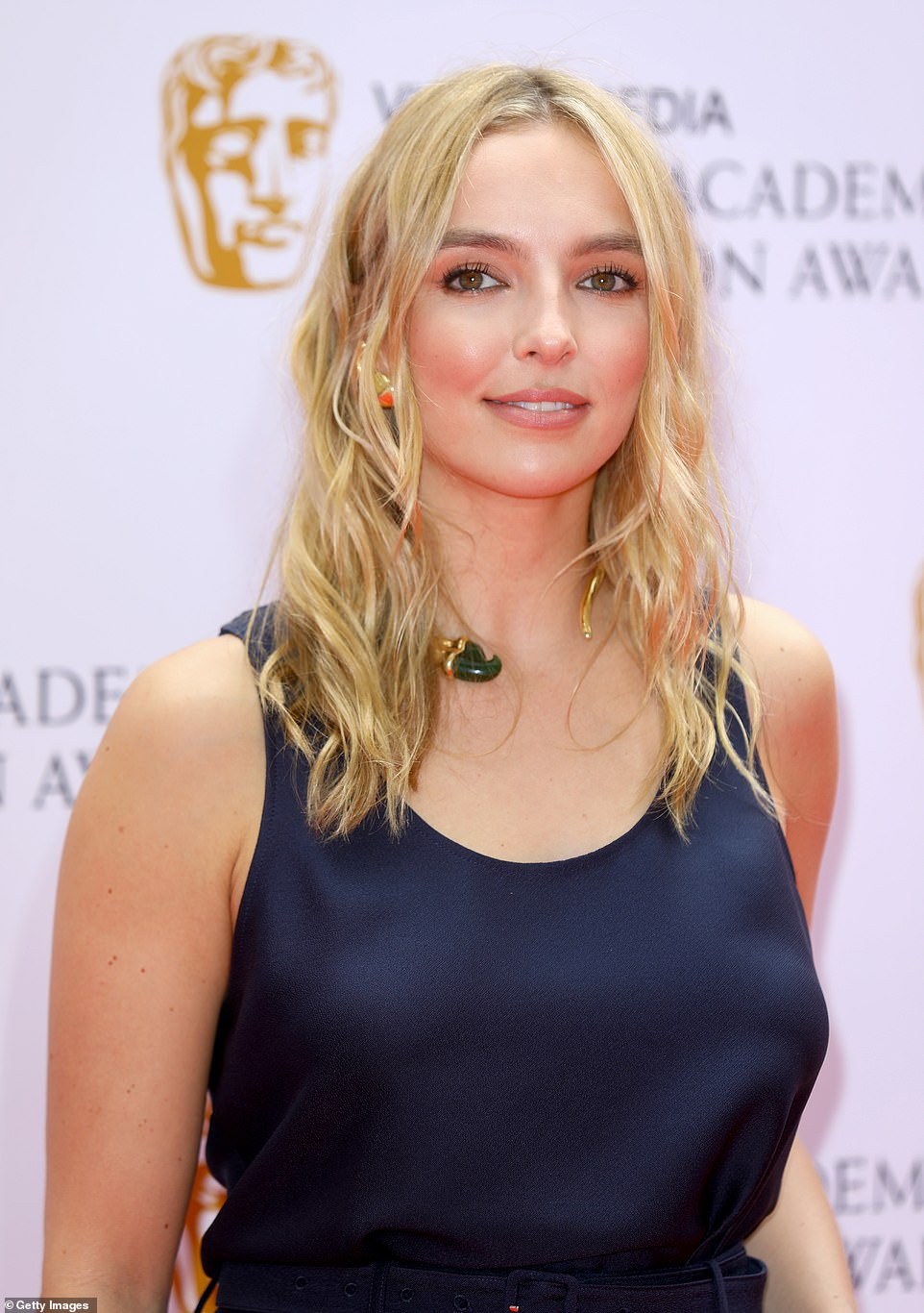 Bold jewellery: While her ensemble was simple, she added bold jewellery, including an open choker and colourful earrings