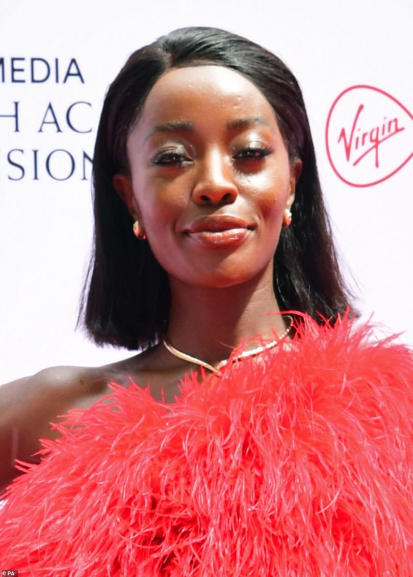 Beautiful: AJ oozed glamour and looked radiant in the jewel toned ensemble and opted for a natural makeup look