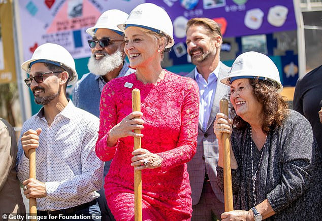 Ready to break ground:At the event, the Basic Instinct actress donned a hard hat and held a shovel as she posed for a photo with Irwin Rappaport, Phill Wilson and Jeanne White-Ginder