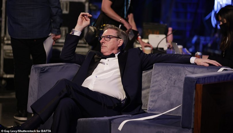 Quick rest:Line Of Duty star Adrian Dunbar, 62, ensured to sneak in a moment to relax amid all the festivities as he lounged on a sofa backstage at London 's TV Centre during theBAFTA TV Awards 2021 on Sunday
