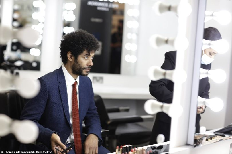 Getting ready: The BAFTA TV Awards host Richard Ayoade ensured he was looking dapper in a navy suit and red tie, with the comedian catching a quiet moment to himself backstage before entertaining viewers