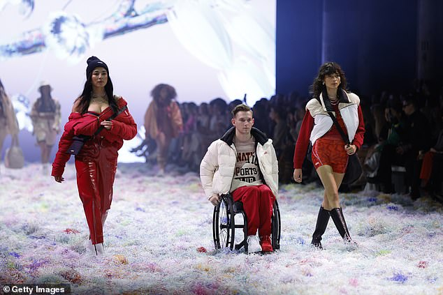 Outrage:Australian Fashion Week organisers have been blasted online for promoting 'inclusivity' yet making their final catwalk barely accessible for wheelchair users. Pictured:Rheed McCracken (centre) in P.E Nation for the show's finale