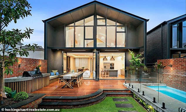 Big spender: The last home purchased by Hughes was an Elsternwick cottage renovated by Josh Barker and model Elyse Knowles