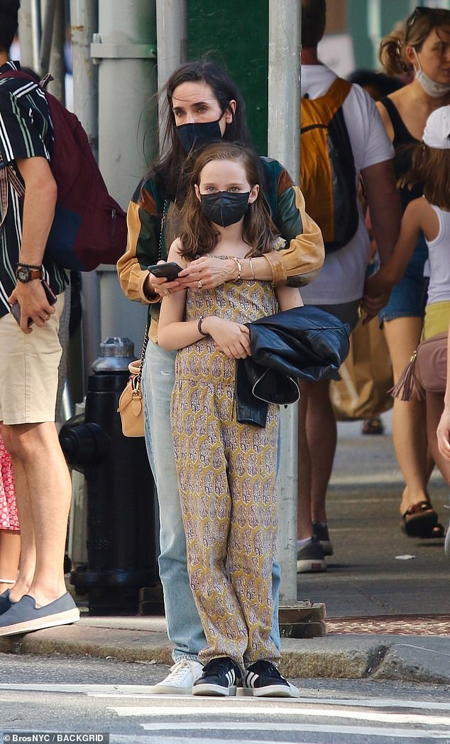 Wrapped around you finger: At one point, the New York native stood on a street corner with her arms firmly wrapped around Agnes as she checked her phone