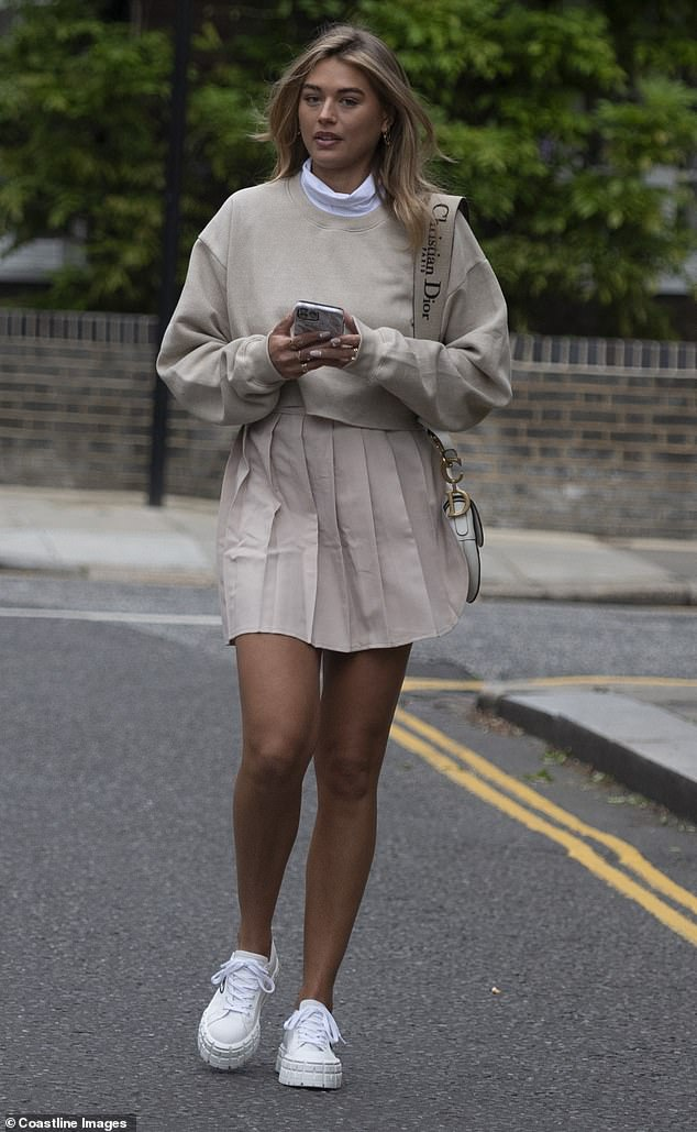 Wow! Arabella Chi commanded attention as she flaunted her slender pins in an all-beige PrettyLittleThing ensemble while out in London on Sunday