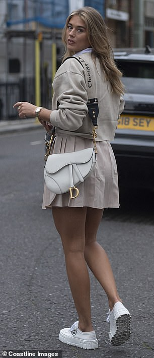 Flaunt it! She opted for comfort with a pair of white Prada trainers