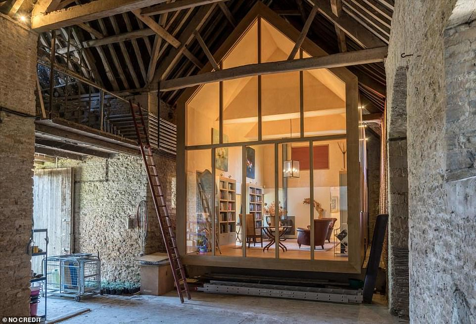 Wow! The home's reading space leads off a separate area of the house, which itself has been kept with the original brickwork and beamed ceilings