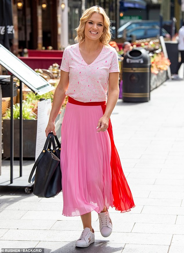 Sweet:Charlotte Hawkins has said she is 'full of admiration' for her GMB co-star Kate Garraway amid her husband Derek Draper's ongoing health battle (pictured on Monday in London)