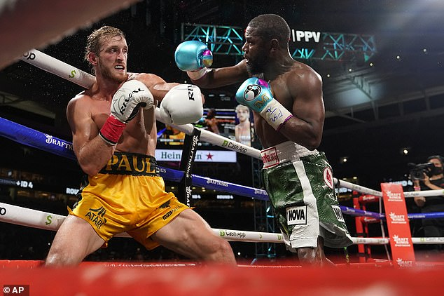 Head to head: Logan caused a major shock by going the full distance against boxing legend Floyd in the exhibition fight