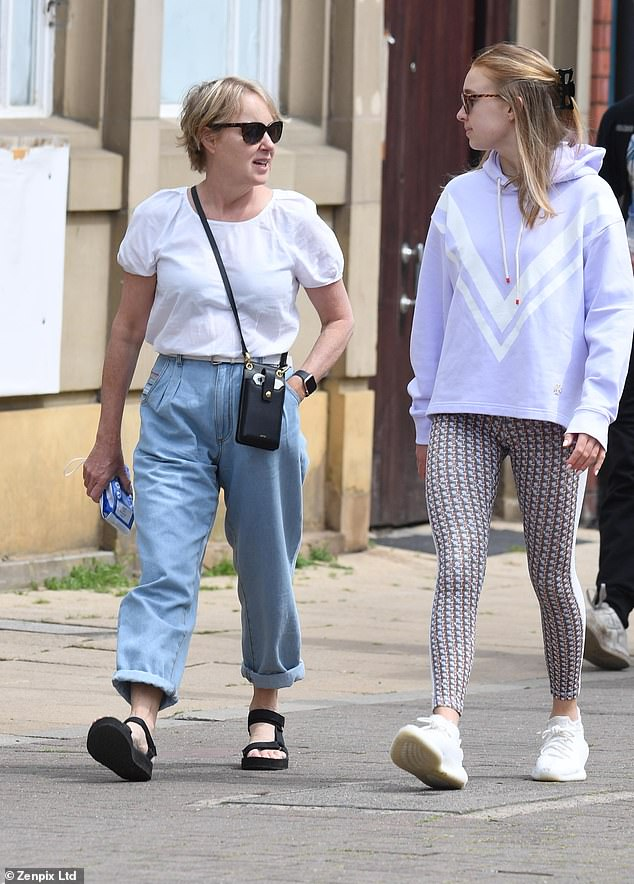 Relaxed:The Coronation Street star, 57, cut an effortlessly stylish figure in light denim jeans and a white shirt while her daughter opted for patterned leggings and a jumper