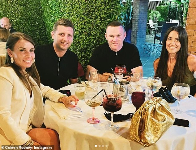 Dinner:In a third picture, Coleen and Wayne enjoyed an up-market dinner with two friends, with mother-of-four Coleen slipping into a gorgeous all-white ensemble