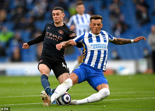 Brighton rejected a £25m bid from Leeds last season for the 23-year-old centre back (right)