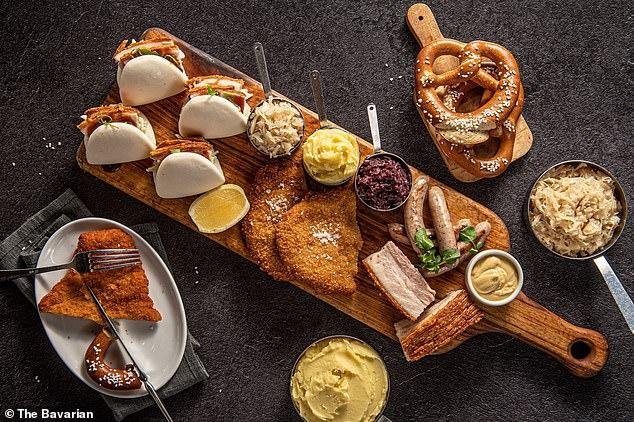 The $59 Ultimate Pork Platter includes crackling pork belly, Nurnberger bratwurst, crisp pork schnitzel and barbecue pork bao buns, served with sides of sauerkraut, red cabbage, creamy mash, lashings of German mustard and bier jus