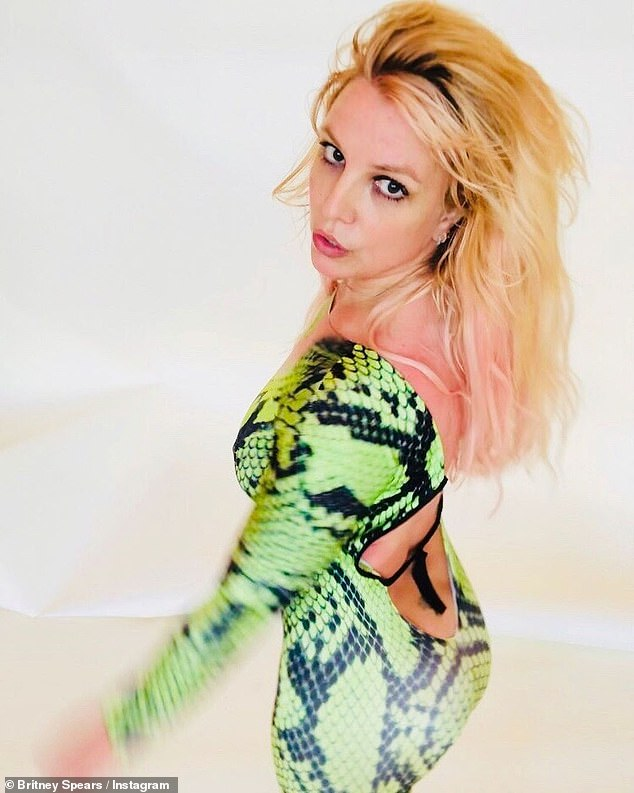 Iconic:Just one day earlier, Britney channeled one of her most iconic performances of all time in a bright green and black figure-hugging reptile print jumpsuit