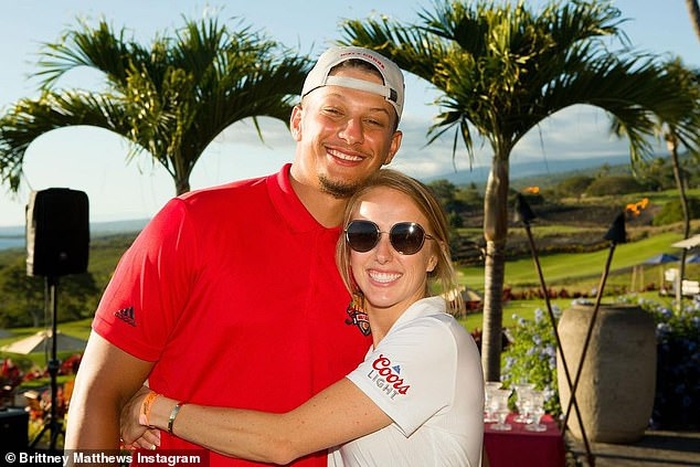 Champion: The couple also shared a hug for the cameras after the golf charity