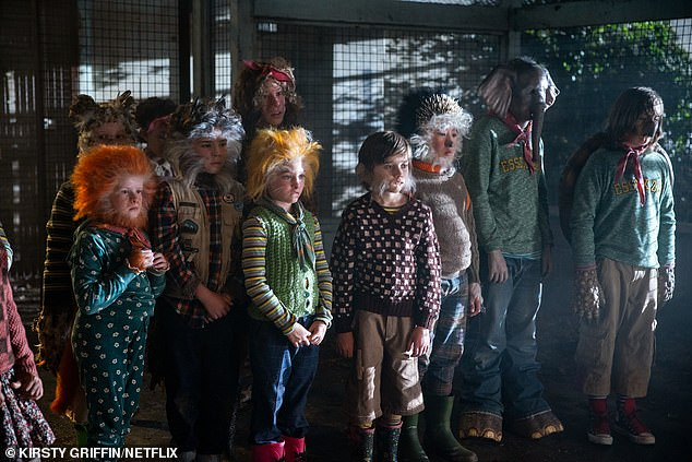 Tracked down: The country has been devastated by a deadly virus that arrived just as human–animal hybrids began to be born, leading unaffected people to hunt them in the belief that they caused the virus; still from Sweet Tooth