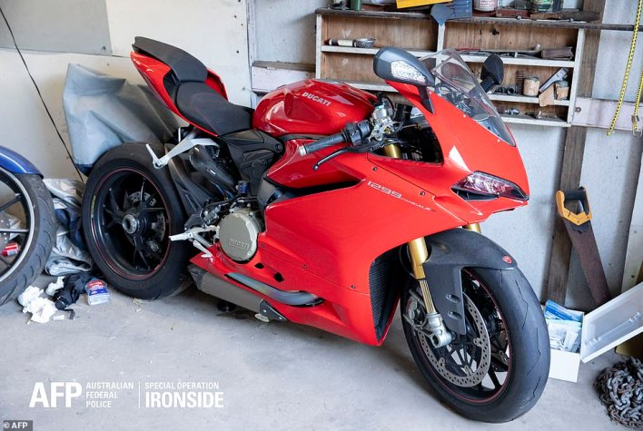 A luxury Ducati motorcycle was among the hundreds of items seized by AFP officers during raids as part of Operation Ironside