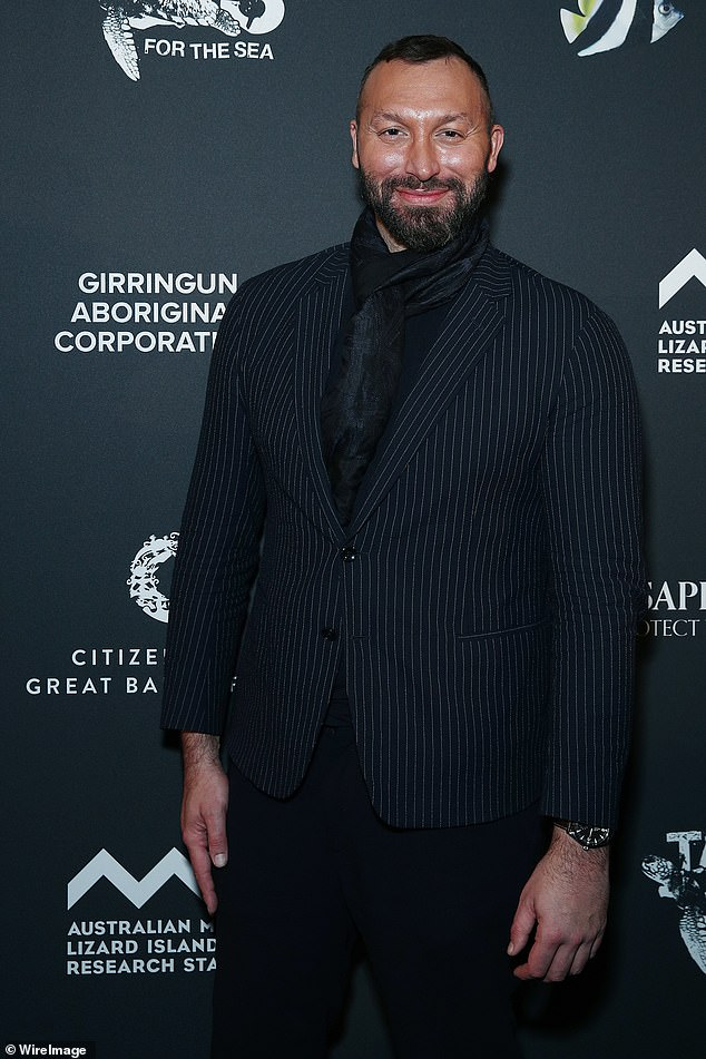 The right stripes: The 38-year-old former Olympic swimmer stepped out in a pinstripe blazer with a black scarf knotted around his neck for the charity event