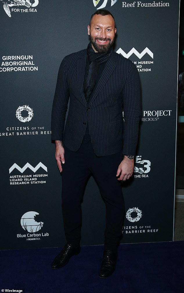 Keeping warm: Ian Thorpe rugged up against the cold weather when he stepped out for The Sapphire Project launch in Sydney on Tuesday